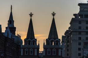 Silhouette of the History Museum and Resurrection Gate on Red Square at Sunset by Michael