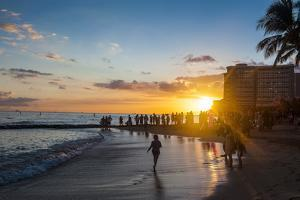 Sunset over the High Rise Buildings on Waikiki Beach by Michael