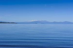 The Blue Waters of Lake Taupo with the Tongariro National Park in the Background by Michael