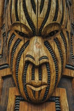 Traditional Wood Carved Mask in the Te Puia Maori Cultural Center by Michael
