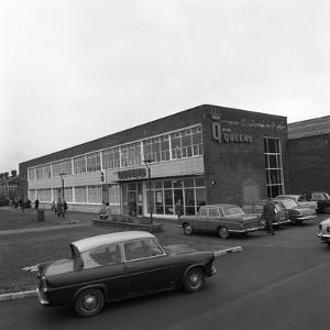 A Ford Anglia Outside Asda (Queens) Supermarket, Rotherham, South Yorkshire, 1969 by Michael Walters