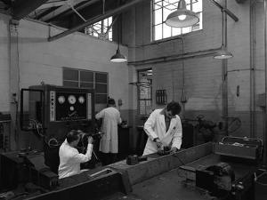 Auto Electricians at Work at Globe and Simpson, Nottingham, Nottinghamshire, 1961 by Michael Walters