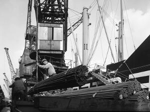 Dockers Loading Steel Bars onto the Manchester Renown, Manchester, 1964 by Michael Walters