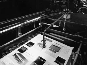 Heidleberg Cylinder Press in Operation at a Printworks, Mexborough, South Yorkshire, 1959 by Michael Walters