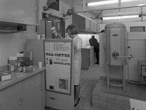 Loading a Drinks Vending Machine at an Experimental Kitchen in Sheffield, South Yorkshire, 1966 by Michael Walters