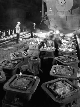 Pig Casting at the Park Gate Iron and Steel Co, Rotherham, South Yorkshire, 1964 by Michael Walters