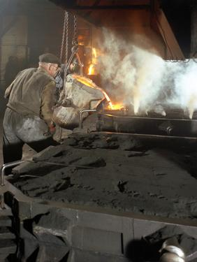 Pouring Molten Metal from a Cupola into Moulds, Steel Bath Production, Hull, Humberside, 1965 by Michael Walters