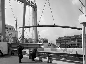 Steel Bars Being Loaded onto the Manchester Renown, Manchester, 1964 by Michael Walters