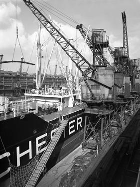 The Manchester Renown Being Loaded with Steel for Export, Manchester, 1964 by Michael Walters