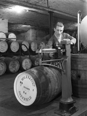 Weighing Barrels of Blended Whisky at Wiley and Co, Sheffield, South Yorkshire, 1960 by Michael Walters