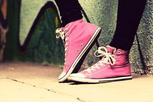 Close up of Pink Sneakers Worn by a Teenager. Grunge Graffiti Wall, Concepts of Teen Rebel, Problem by Michal Bednarek