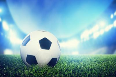Football, Soccer Match. A Leather Ball on Grass on the Stadium by Michal Bednarek
