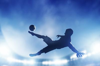 Football, Soccer Match. A Player Shooting on Goal Performing a Bicycle Kick. Lights on the Stadium by Michal Bednarek