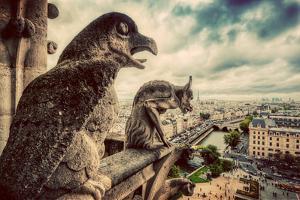 Gargoyles and Chimera Statues of Notre Dame over Paris, France Skyline. Dark Clouds, Vintage by Michal Bednarek