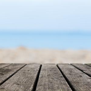 Grunge Rustic Real Wood Boards on the Beach Shore, Ocean Background. Place for an Object. by Michal Bednarek