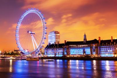 London, England the UK Skyline in the Evening. Ilumination of the London Eye and the Buildings Next by Michal Bednarek