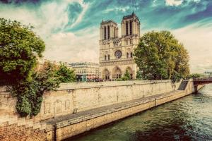Notre Dame Cathedral in Paris, France and the Seine River Embankment on a Sunny Day. Vintage by Michal Bednarek