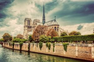 Notre Dame Cathedral in Paris, France and the Seine River. Moody Clouds by Michal Bednarek