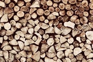 Pile of Brown Wood Logs Background, Pattern. Vintage Tone by Michal Bednarek