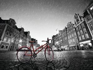 Red BikeOn Cobble Stone Street by Michal Bednarek