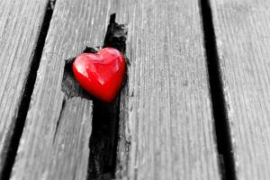Red Heart in Crack of Wooden Plank, Symbol of Love, Valentine's Day by Michal Bednarek