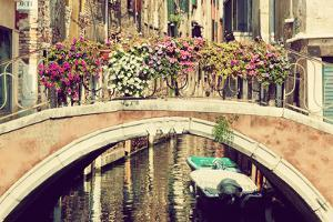 Venice, Italy. A Bridge with Flowers Buquet over a Narrow Canal among Old Venetian Architecture. Vi by Michal Bednarek