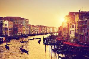 Venice, Italy. Gondolas on Grand Canal, Italian Canal Grande at Gold Sunset. View from Rialto Bridg by Michal Bednarek