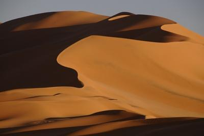 Sand dunes at sunset in the Sahara Desert, Libya, North Africa, Africa by Michal Szafarczyk
