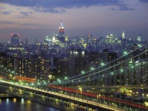 Manhattan Bridge and Skyline at Night by Michel Setboun
