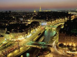 Overlooking Paris at Night by Michel Setboun