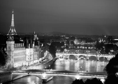 Paris and Seine river at night by Michel Setboun