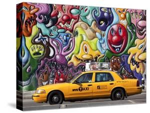 Taxi and mural painting in Soho, NYC by Michel Setboun