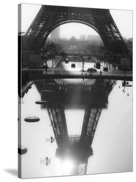 The Eiffel tower reflected, Paris by Michel Setboun