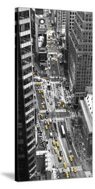 Yellow taxi in Times Square, NYC by Michel Setboun