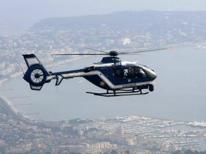 A Gendarme Helicopter is Seen Above the Bay of Cannes by Michel Spingler
