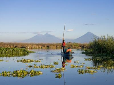 Fisherman, Agua and Pacaya Volcanoes in the Background, Monterrico, Pacific Coast, Guatemala by Michele Falzone