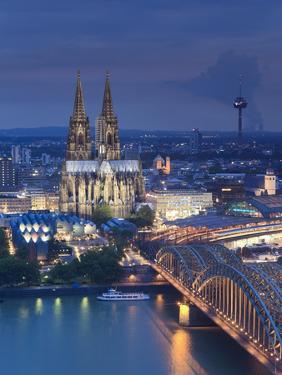 Germany, North Rhine Westphalia, Cologne (Koln), Hohenzoller Bridge over River Rhine and Cathedral by Michele Falzone