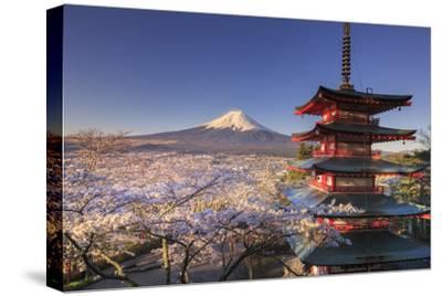 Japan, Yamanashi Prefecture, Fuji-Yoshida, Chureito Pagoda and Mt Fuji During Cherry Blossom Season by Michele Falzone