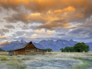 Old Barn and Teton Mountain Range, Jackson Hole, Wyoming, USA by Michele Falzone