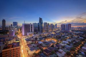 Philippines, Manila, Makati Business District, Makati Avenue and City Skyline by Michele Falzone