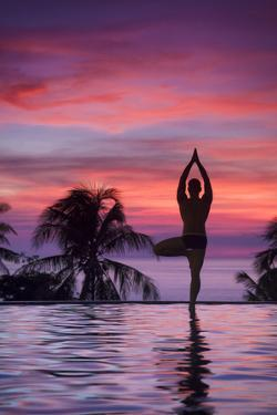 Philippines, Visayas, Boracay Island, Man Practising Yoga (Tree Pose) at Luxury Resort by Michele Falzone