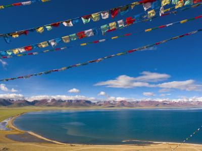 Prayer Flags at Nam Tso Lake, Central Tibet by Michele Falzone