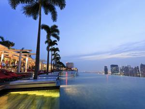 Singapore, Swimmingpool and Singapore Skyline on the 57th Floor of Marina Bay Sands Resort by Michele Falzone