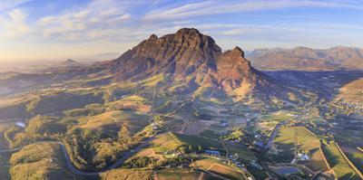 South Africa, Western Cape, Stellenbosch, Aerial view of Simonsberg Mountain range and Stellenbosch by Michele Falzone