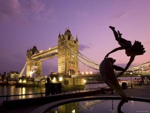 Tower Bridge and Girl with a Dolphin Fountain Statue at Dusk, London, England by Michele Falzone