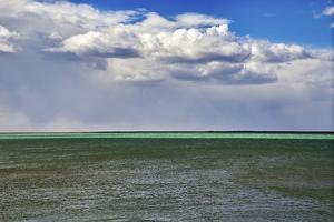 Argentina, Santa Cruz. Puerto Santa Cruz, river Santa Cruz under stormy clouds. by Michele Molinari