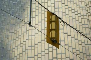 Canada, Ontario, Toronto. Streetlight rear and building facade by Michele Molinari