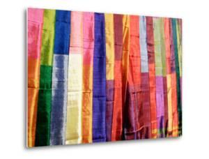 Colorful Silk Scarves at Edfu Market, Egypt by Michele Molinari