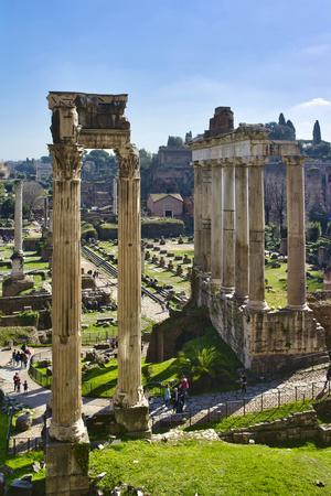 Italy, Rome, temple and arch ruins at Roman Forum