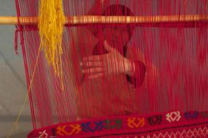 Rug making is a typical women job. by Michele Molinari